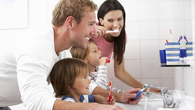 Family Brushing Teeth after Buying new Toothbrushes